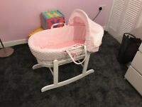 Girls Pink and White Moses basket on rocking stand barely used