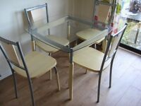 Glass top table & 4 chairs. Good condition.