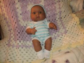 a genuine berenguer doll in good condition.