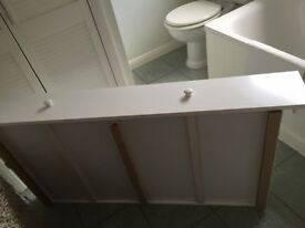 White wooden cot drawer