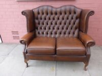 A Tanny Brown Leather Chesterfield Queen Ann High Back Sofa