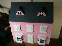 lovely pink and white wooden childrens dolls house