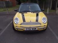 Yellow Mini Cooper Hatchback