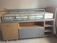 Childrens mid sleeper bed with desk and drawers.