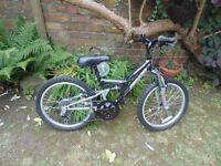 "Bicycle Boys' black frame, six gears, 20"" wheels"