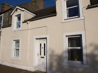 Traditional terraced house in Whithorn, 2 bedrooms, double glazed, electric heating. Private garden.