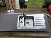 Stainless steel sink with stainless steel mixer tap