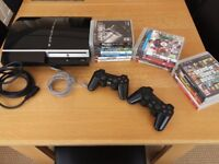Playstaion 3 bundle with two wireless remotes and 17 games!!