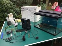Set of 4 fish aquariums and accessories for one