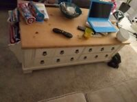 Lovely coffee table with 4 drawers and magazine rack to one end
