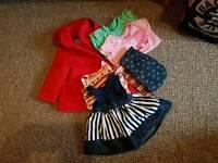 Two full bag for life bags full of girls clothing