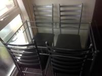 Glass and silver dining table & 4 chairs