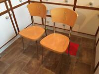 2x wooden and chrome dining chairs