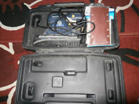 Electric Sander with assorted sand paper sheets
