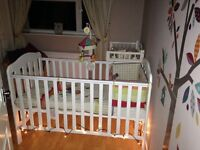 Mamas and papas Eloise cotbed cot which changes to toddler bed painted white with baby grade paint.