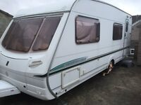 2004 Abbey Adventura 330 6 berth caravan, complete with awning and various accessories.