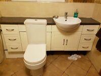 Toilet + vanity units very stylish including worktop