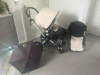 Bugaboo cam 2 inc carry cot and off white fabrics