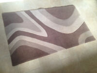 Modern design rug, good condition. Colours beige, cream and brown.