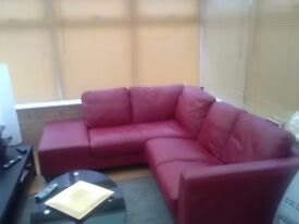 Red leather corner suite. Very good condition. Size 7ft 6 x 6ft 6.