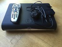 Sky+ HD Box Amstrad DRX 890 with remote control, wireless connector box and power cable