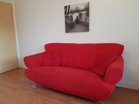 House clearance: 3 seater and 2 seater vibrant red sofas