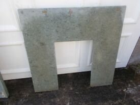 Grey marble fireplace surround