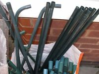 Various metal poles and shelves to make oudoor greenhouse type shelves