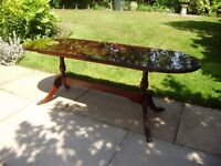 Beresford Hicks coffee table in mahogany with glass top.