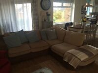 Corner Sofa, no pets and nonsmoking home, good condition. Light brown fabric with dark brown base.