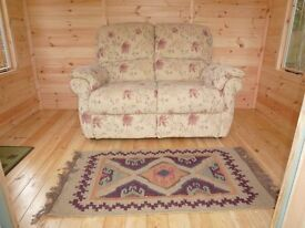 Compact 2 seater sofa with fresh floral patterned fabric in as new condition
