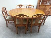 Ducal extending pine dining table and six chairs.