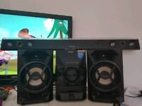 Samsung digital soundbar and sony stereo system with iphone docking
