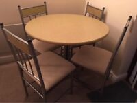 Very clean and tidy compact table and four matching chairs.