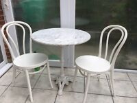 Marble and cast iron bistro table and 2 chairs with chair pads