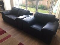 Three piece black leather sofa set