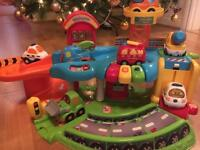 Vtech toot toot garage & 2sets of vehicles