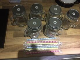 Glass drinking jars with lids and straws