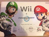 Wii Nintendo + Mariokart Wii with remote,steering wheel & game +Additional Games & skylander Games
