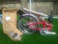 Red Raleigh Parkway folding bike. Brand new, never assembled.