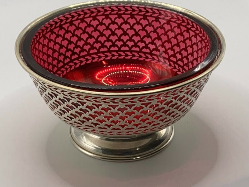 Cranberry dish in sterling silver