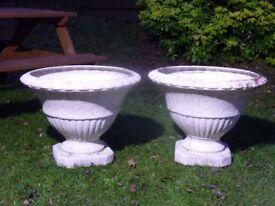 2x large decorative plastic planters.