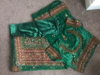 A high quality green net sari with embroidery with a matching petticoat and size 12-14 blouse