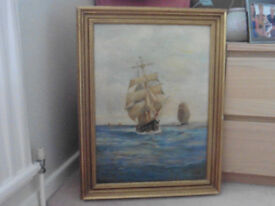 Painting of two galleons in full sail, oil on canvas dated 8/10/1915 in moulded gilt frame