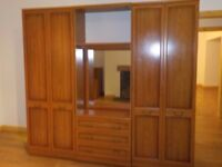 Bedroom Suite - 2 Extra Tall Wardrobes, Middle Dressing Table, Tall Chest Drawers, Bedside Cabinet.
