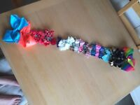 Collection of hair bows and accessories including 4 Jo Jo bows