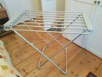 Heated clothes dryer