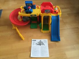 Fisher price toy garage with 2 cars and figures