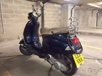 DARK BLUE PIAGGIO VESPA (2011) LX125 MODEL. GOOD CONDITION