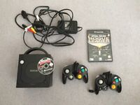 Black Nintendo Gamecube with Controllers and Games